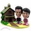 Polyresin Casual Couple With Log Cabin Bobblehead