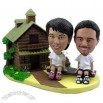 Polyresin Couple On Seesaw Outside A Log Cabin Bobblehead
