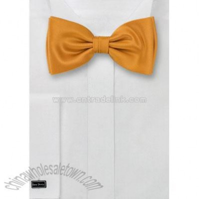 Amber yellow bow tie with elegant golden shine.