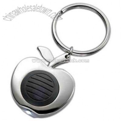 Apple shape silver key ring with white beam of light