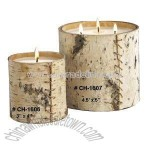 Candle in glass cylinder jar with bark wrap