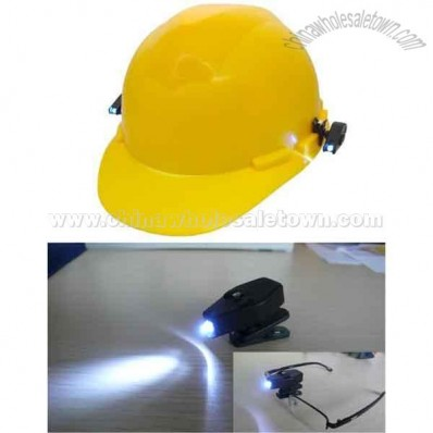 Clip-on LED light for safety glasses and hard hats