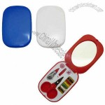 Compact 13 piece sewing kit with enclosed mirror
