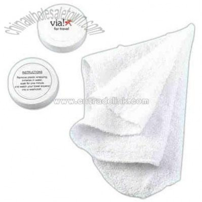 Compressed hand towel or face cloth