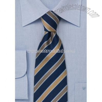 Dark blue striped silk tie Striped tie in midnight blue, with tan and bronze stripes