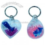 Dolphin in water key chain in assorted shapes
