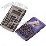 Eight digit flipper calculator with rubber grid and raised soft rubber key