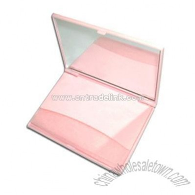 Facial oil blotting paper in plastic case with mirror