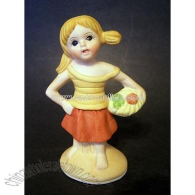 Girl Holding Basket? Porcelain Figurine