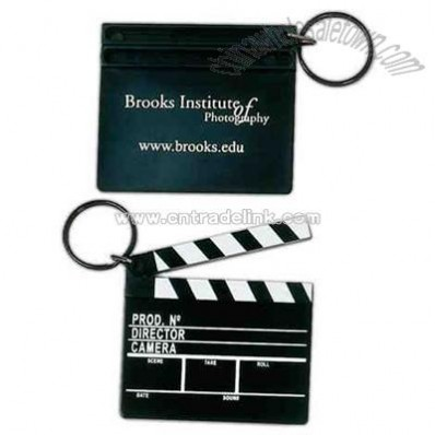 Key holder with plastic clapboard replica