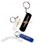 Key holder with whistle and light