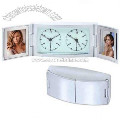 Matte silver dual time alarm clock with glow in the dark dial and double frame.