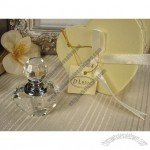 Mini crystal perfume bottle in satin lined heart box