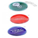 Reusable drink coaster with vibrant colored liquid