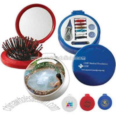 Round shape personal travel kit includes mirror, sewing kit and hairbrush