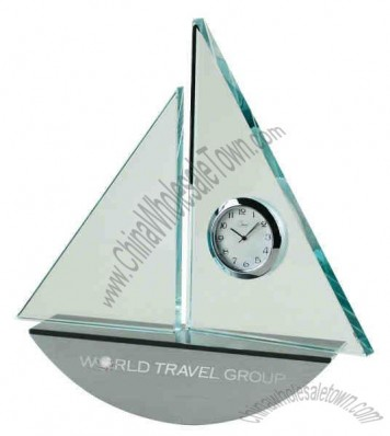 Sail boat shape clock with clear glass sails and rocking boat base