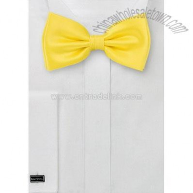 Solid bright lemon yellow bow tie.