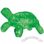 Translucent green turtle shaped massager