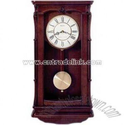 Wall clock in solid wood case