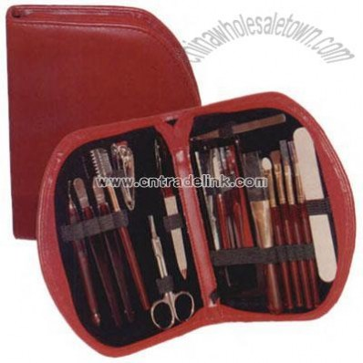 Women's red simulated leather cosmetic kit with manicure and makeup sets