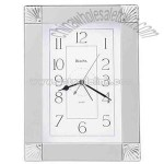 silver metal case clock